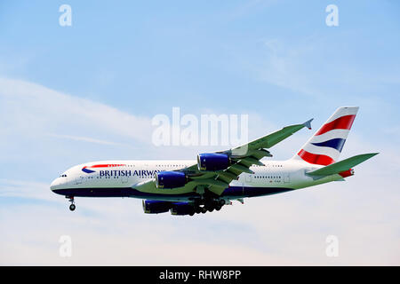 HONG KONG - JUNE 04, 2015: British Airways A380 landing at Hong Kong airport. British Airways is the flag carrier airline of the United Kingdom and th - Stock Photo