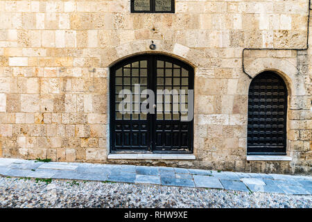 The Street of the Knights (Ippoton) was home from the 14th century to the Knights Hospitaller who ruled Rhodes. They were divided into seven 'tongues' - Stock Photo