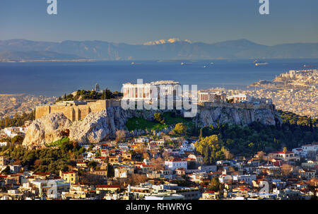 Aerial view over Athens with te Acropolis and harbour from Lycabettus hill, Greece at sunrise - Stock Photo