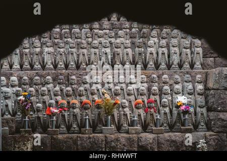 a wall of Jizō Statues in Kamakura - Stock Photo