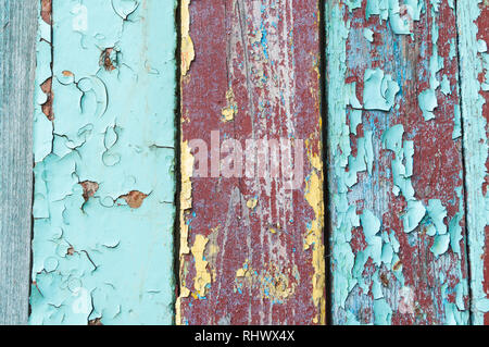 Texture background - old painted wooden surface with peeling blue and brown paint. Colorful texture wooden background - Stock Photo