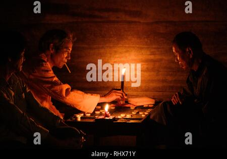 November 20, 2018 - Hội An, Vietnam - Old men playing the game Xiangqi, also called Chinese chess. They are sitting outside a house in the centre of Hoi An. Credit: Daniel Dohlus/ZUMA Wire/Alamy Live News - Stock Photo