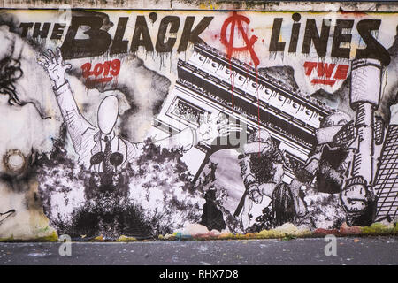 Paris, Ile de France, France. 3rd Feb, 2019. Grafitti representing a scene that happened during the Yellow Vests protest since the movement started on 17th November 2018. 20 artists from the Black Lines movement directed a 300 meter fresco on a wall of rue d'Aubervilliers in the 19th district (arrondissement) of Paris, on the theme of the Yellow Vests movement. Credit: Thierry Le Fouille/SOPA Images/ZUMA Wire/Alamy Live News - Stock Photo