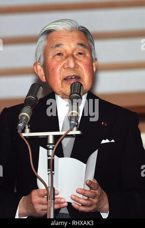 Tokyo, Japan. 23rd Dec, 2012. Emperor Akihito reads a statement to a throng of well-wishers from behind the bullet-proof glass panel of the Imperial Palace balcony in Tokyo on Sunday, December 23, 2012. More than 20,000 well-wishers turned out to the palace, celebrating the 79th birthday of the monarch, who said in his statement that he's concerned about the country's aging population. Credit: AFLO/Alamy Live News - Stock Photo