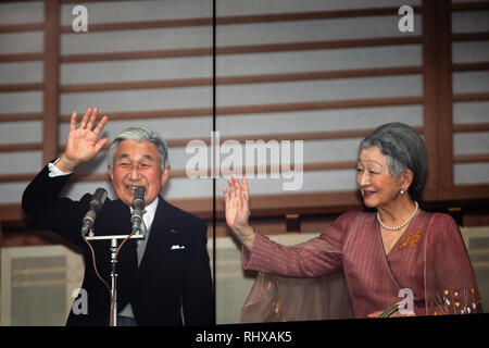 Tokyo, Japan. 23rd Dec, 2012. Emperor Akihito, accompanied by Empress Michiko, waves to a throng of well-wishers from behind the bullet-proof glass panel of the Imperial Palace balcony in Tokyo on Sunday, December 23, 2012. More than 20,000 well-wishers turned out to the palace, celebrating the 79th birthday of the monarch, who said in his statement that he's concerned about the country's aging population. Credit: AFLO/Alamy Live News - Stock Photo