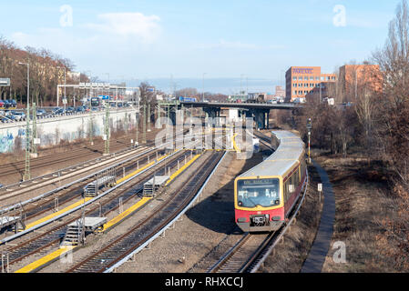 Berlin, Germany - January 28, 2019: View of a moving S-Bahn in Berlin's Charlottenburg district, Germany. - Stock Photo