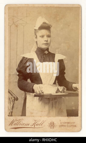 Victorian Carte de Visite of Parlour Maid carrying a tray, with a teacup on it, William Hull studio, Upper Clapton, London, dated Sept.1894 - Stock Photo