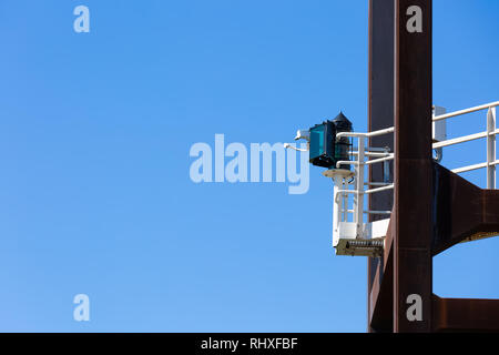 Signal light on a tower in the harbor - Stock Photo