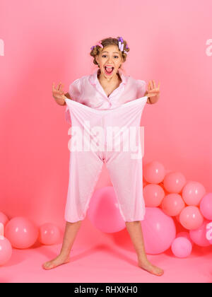 Pajama party balloons on pink studio background. - Stock Photo