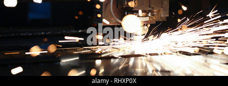 Sparks fly out machine head for metal processing - Stock Photo