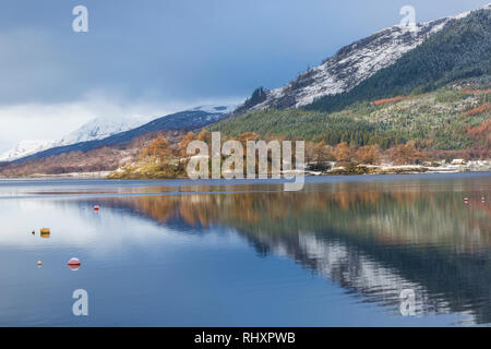 Reflections in Loch Leven on a cold winter morning from Glencoe Village, Highlands, Scotland in January - Stock Photo