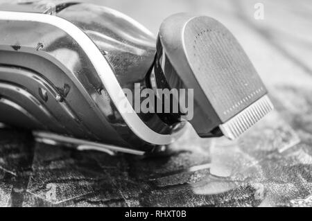 Close up of the blades of a man's electric shaving machine trimmer - Stock Photo