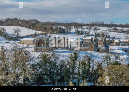 Egglestone Abbey, Barnard Castle, Teesdale in a snowy landscape and winter sunshine - Stock Photo