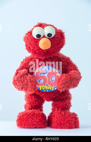 A toy of Elmo, the Muppet character on Sesame Street holding