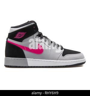 VIENNA, AUSTRIA - AUGUST 7, 2017: Nike Air Jordan 1 Retro High GG grey, black and pink sneaker on white background. - Stock Photo