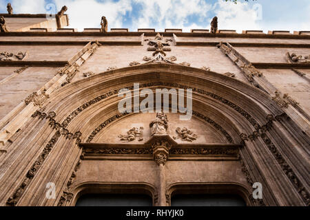 Decorative arched doorway entrance and gargoyles to the Silk Exchange in Valencia Spain - Stock Photo