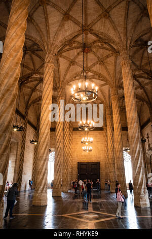 Tourists in the Hall of Columns, Trading Hall, in the Silk Exchange Valencia Spain - Stock Photo