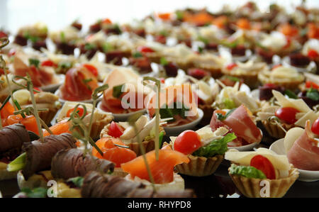Close up view of big set of appetizers on the table settings for the food presentation - Stock Photo