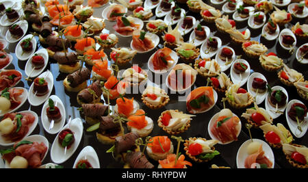Huge set of starters and appetizers on the table for banquet - Stock Photo