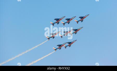 DUBAI, UAE - NOVEMBER 11, 2007: The oldest aerobatic demonstration team in the world, the French Patrouille de France, flying over Dubai in the UAE. - Stock Photo