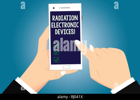 Text sign showing Radiation Electronic Devices. Conceptual photo radio frequency emitted by electronic devices Hu analysis Hands Holding Pointing Touc - Stock Photo