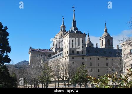 The royal monastery in San Lorenzo de El Escorial, central Spain on a sunny winter day - Stock Photo