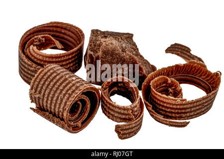 hocolate shavings and chocolate pieces isolated on white background. - Stock Photo