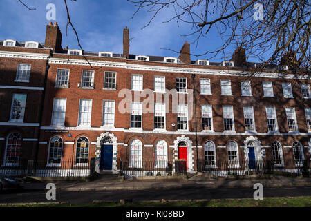 red door,Southernhay West in Exeter ,Georgian buildings at Southernhay West,two terraces of Grade II* listed late 18th century red-brick townhouses - Stock Photo