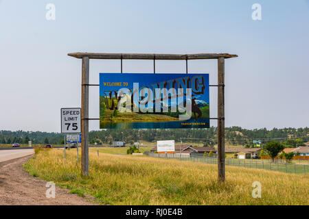 Pine Bluffs, Wyoming, United States - August 15, 2018: Shot of a Welcome Wyoming sign along the interstate I-80 in Pine Bluffs, WY. - Stock Photo
