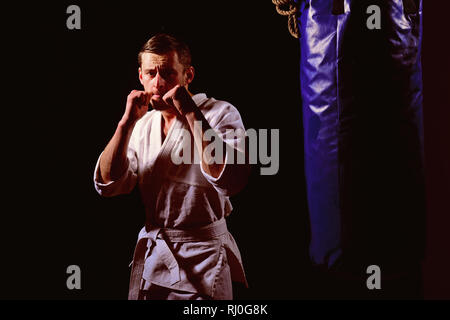 Fighting concept. Fighting man in kimono. Karate man in fighting stance. Keep fighting - Stock Photo