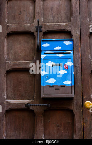 Florence, Italy - March 16, 2012: Old fashioned post box with cute drawing on the brown door. - Stock Photo