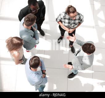 young male and female creative graphic designers collaborating during brainstorming using modern technology - Stock Photo