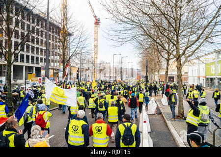 STRASBOURG, FRANCE - FEB 02, 2018: Elevated view of Gilets Jaunes Yellow Vest manifestation on the 12 Saturday of anti-government demonstrations marching on the Boulevard de Dresde Stock Photo