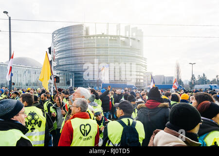 STRASBOURG, FRANCE - FEB 02, 2018: Gilets Jaunes Yellow Vest protesters with French national flag manifestation on the 12 Saturday of anti-government demonstrations European Parliament  Stock Photo
