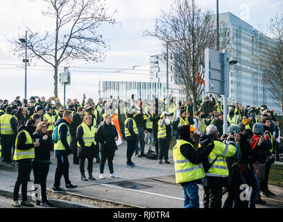 STRASBOURG, FRANCE - FEB 02, 2018: Police and protesters in front of Adidas headquarter during Yellow Vest prottest Stock Photo