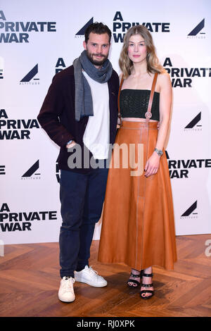 Jamie Dornan and Rosamund Pike attending a special screening of A Private War at Odeon Leicester Square, London. - Stock Photo