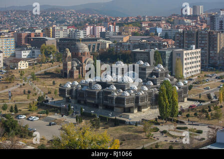 Aerial view of capital city of Pristina, Kosovo with some old buildings like National Public Library and Christ the Saviour Cathedral. - Stock Photo