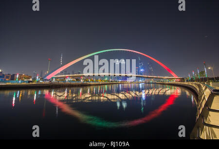 Panorama of night Dubai on the background of the bridge of the Dubai Greek canal. - Stock Photo