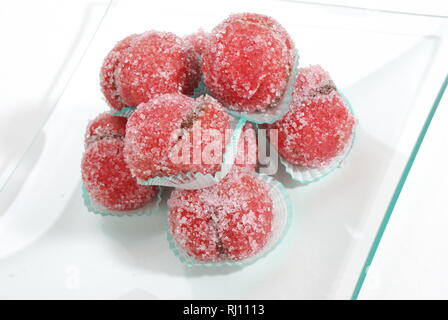 Cakes with chocolate cream and Christmas sugar - Stock Photo