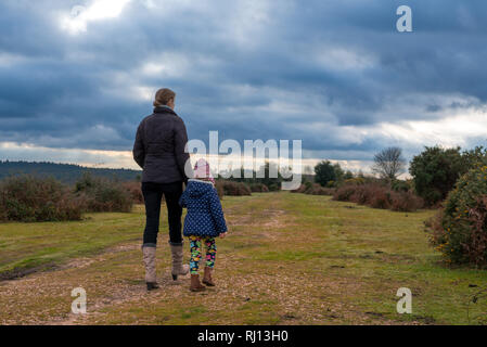 Mother and daughter on a foot path in New Forest countryside - Stock Photo