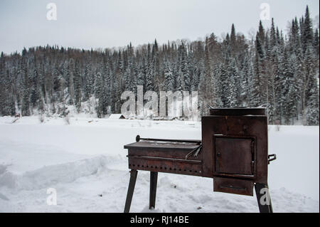 Metal rusty grill in winter forest - Stock Photo