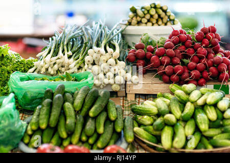 Table with fresh vegetables on the market - picture - Stock Photo