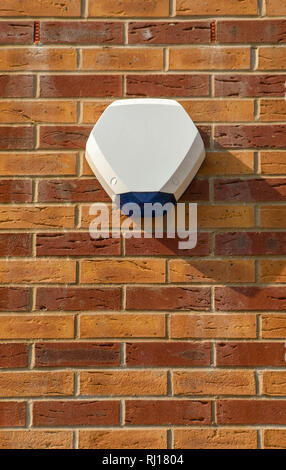 Close up view of the alarm box of an intruder alarm on the exterior wall of a house - Stock Photo
