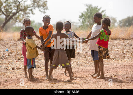 Samba village, Yako Province, Burkina Faso; children playing together. - Stock Photo