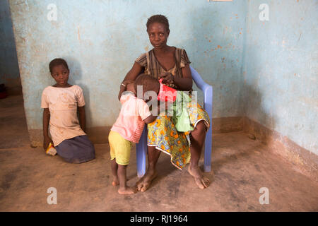 Samba village, Yako Province, Burkina Faso; Sally Zoundi, 35, with her baby Salomon Zoundi, 15 months, and her daughter Zalissa Zoundi, 10. - Stock Photo