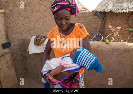 Kourono village, Yako province, Burkina Faso; Elizabeth Toro, 36, with her grand-daughter. - Stock Photo