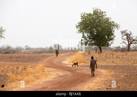 Kourono village, Yako province, Burkina Faso; Moussa Mande's eldest son on the way to the gold mines. He has no education, unlike his younger brothers and sisters. - Stock Photo