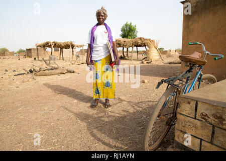 Samba village, Yako Province, Burkina Faso; Helene Pagoundba, nutrition education committee member. - Stock Photo