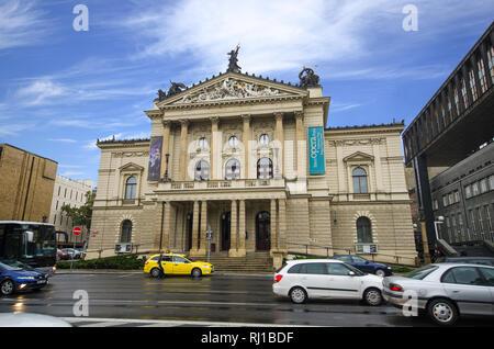 Prague, Czech Republic - Facade of the Statni Opera (State Opera House) in Prague. Exterior of Neo-Renaissance architecture Prague Opera House. - Stock Photo