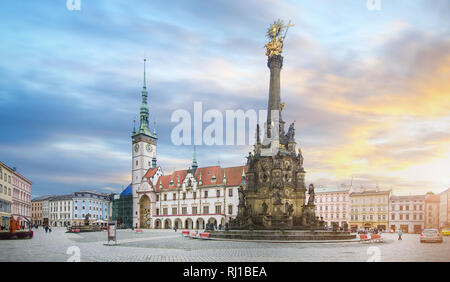 the Square and the Holy Trinity Column enlisted in the Unesco world heritage list and Astronomical clock in the Town Hall in Olomouc, Czech Republic - Stock Photo